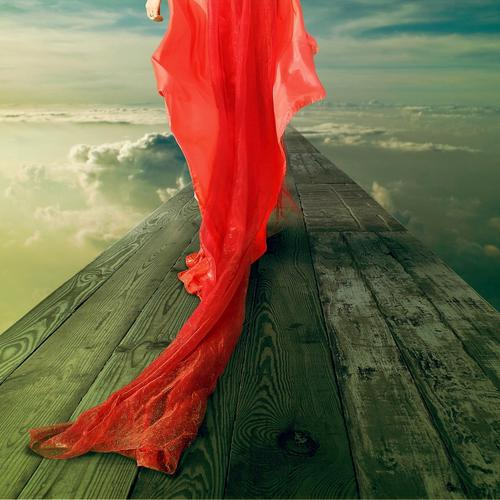 Lady in red dress walks on clouds