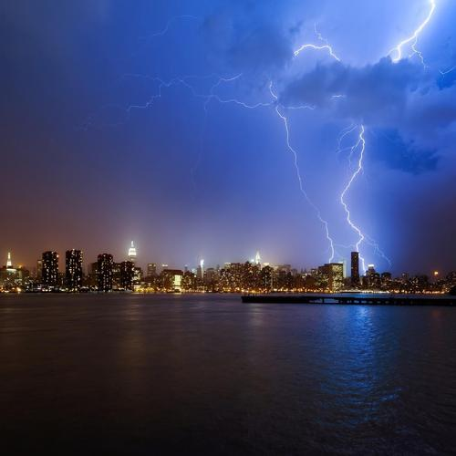 Lightning over New York city in night