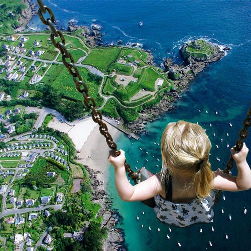 Little Girl On Swing Surreal wallpaper