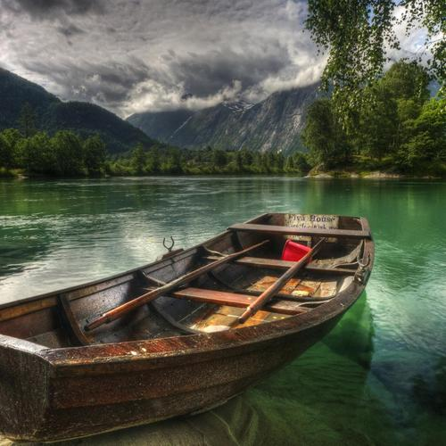 Lonely boat with mean skies wallpaper