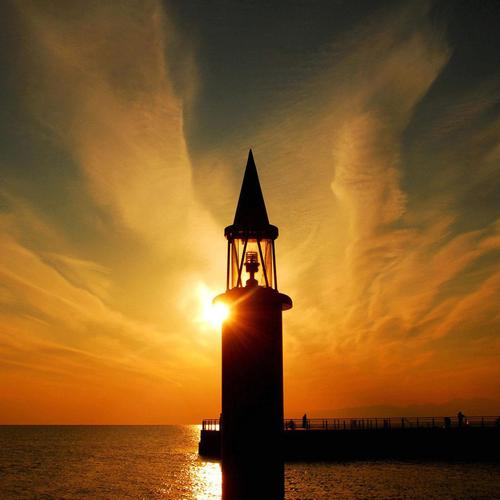 Magnificent lighthouse horizon sunset wallpaper