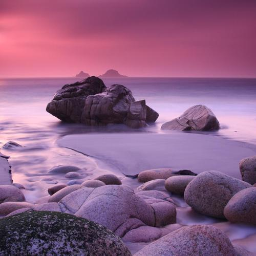 Magnificent purple rocky beach