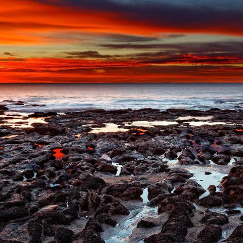 Magnificent red sunset over seashore