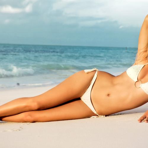 Maria Sharapova at the beach in white bikini wallpaper