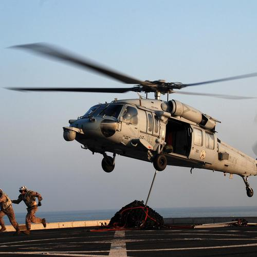 Marines Run From An Mh-60s After Attaching Cargo