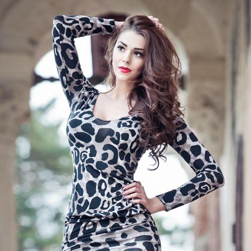 Model in leopard pattern dress wallpaper