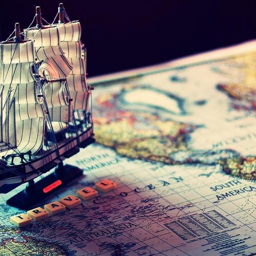 Model ship travels on map wallpaper