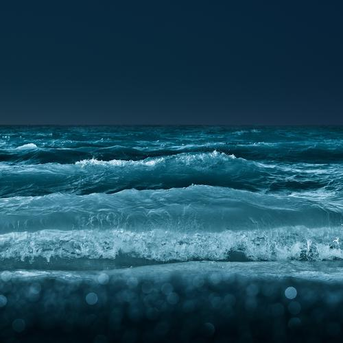 Night waves on the beach