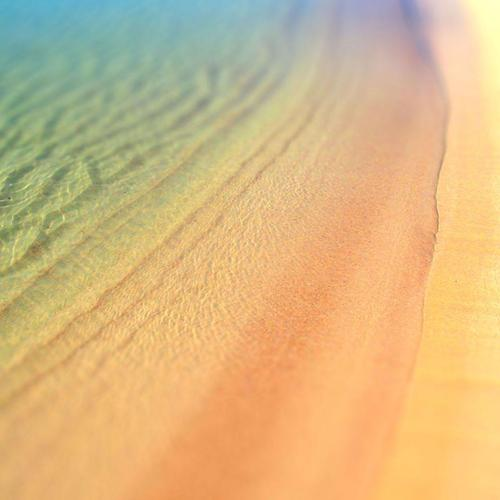 Ocean ripples over beach wallpaper