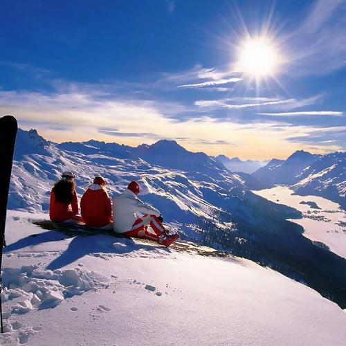 People sitting on the top of snow mountain Switzerland
