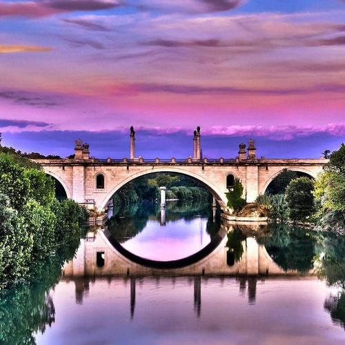Perfect reflection of bridge on river wallpaper