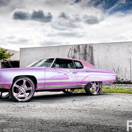 Pink classic car with big wheels wallpaper