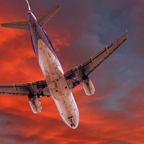 Plane crossing the red sky wallpaper