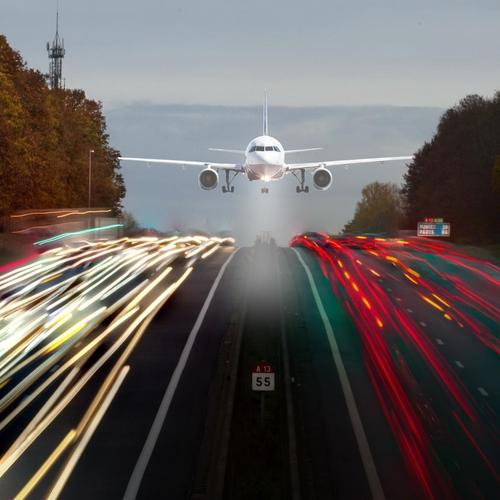 Plane ling on highway wallpaper