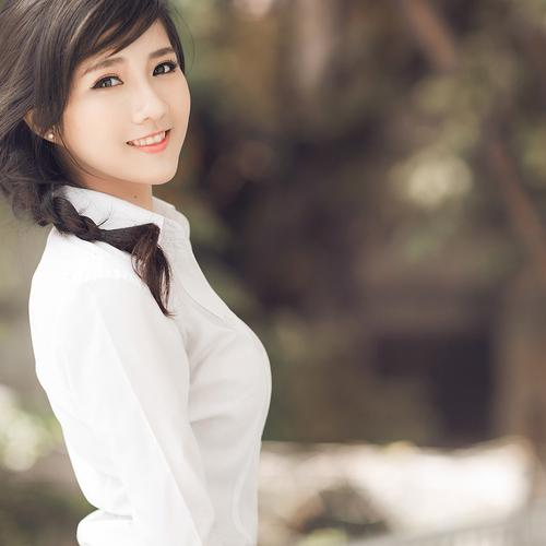Pretty asian girl in white shirt wallpaper