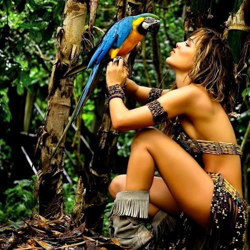 Pretty tarzan girl and parrot