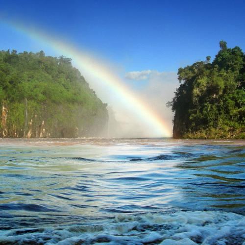 Rainbow over the river In Brazil wallpaper