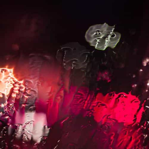 raining window bokeh red light