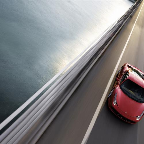 Red Ferrari 458 Italia on the bridge