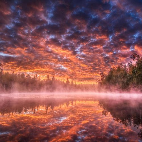 Red lake under fire sky