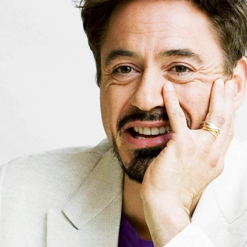 Robert Downey Jr in white suit