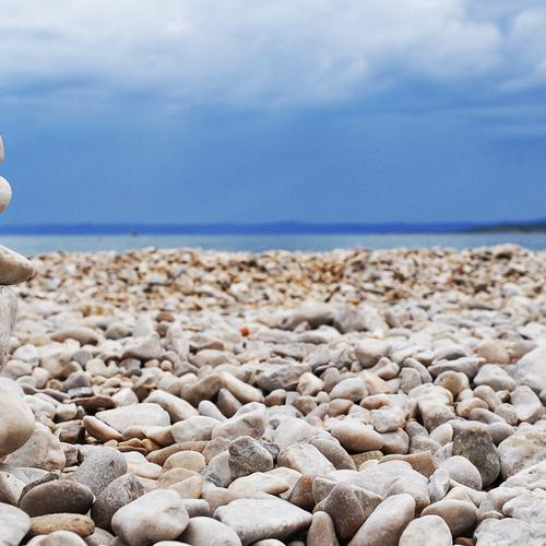 Rock stacking on beach wallpaper