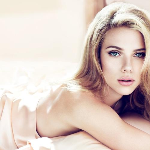 Scarlett Johansson on the bed wallpaper