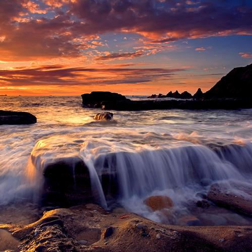 Seashore flow in sunset wallpaper