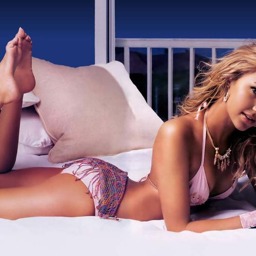 Sexy Arielle Kebbel in pink lingerie on the bed wallpaper