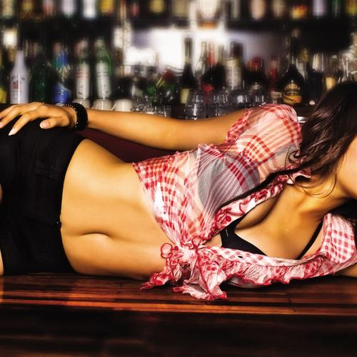 Sexy asian girl lying on the bar counter
