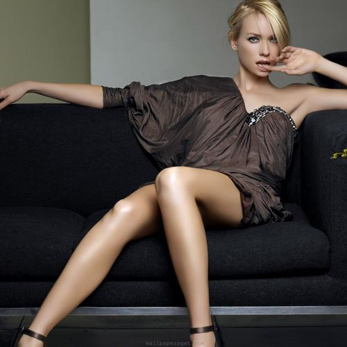 Sexy Naomi Watts sitting on couch