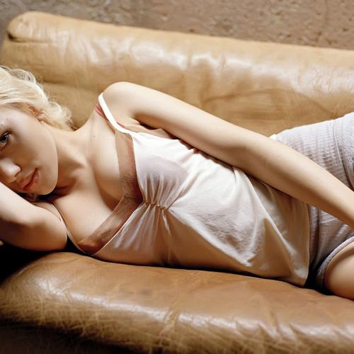 Sexy Scarlett Johansson lying on the sofa wallpaper