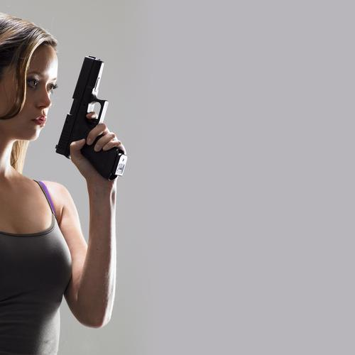Sexy Summer Glau in tank top holding gun wallpaper