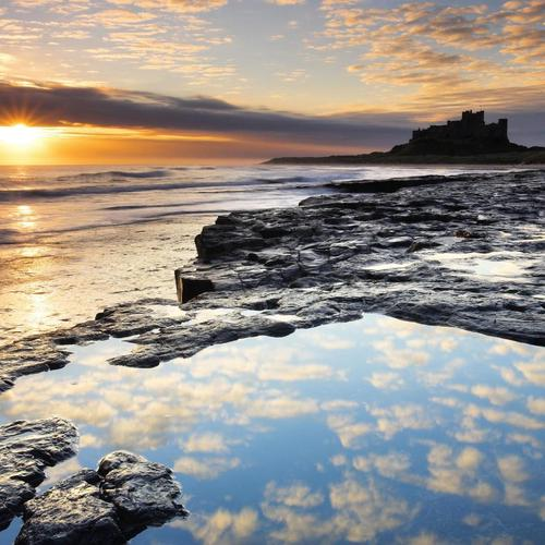Silhouette Of Bamburgh Castle At Sunset wallpaper