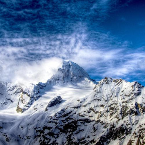 Snow covered mountain peak wallpaper