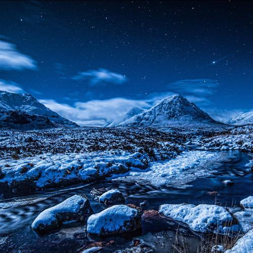 Snow mountain under stars wallpaper