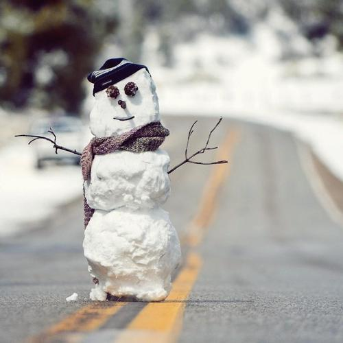 Snowman on the road wallpaper