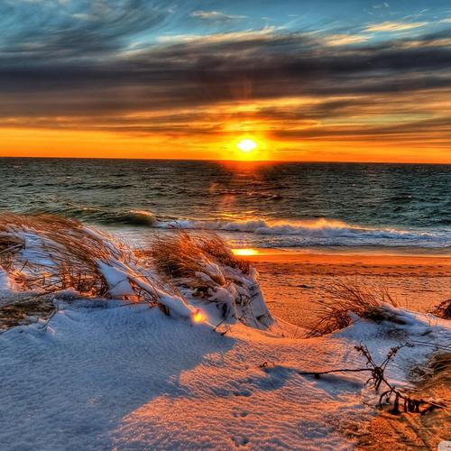 Snowy beach in sunset