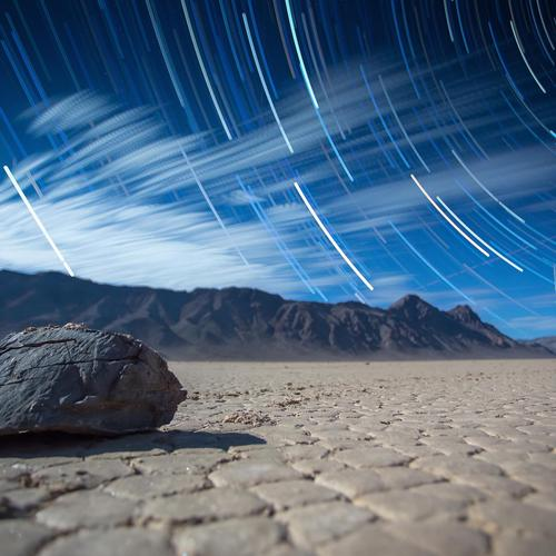 Star trail over the lonely rock