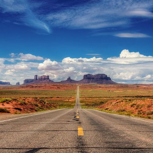 Download Straight highway in the desert High quality wallpaper