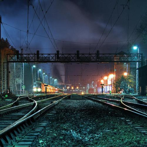 Striking train station late at night wallpaper