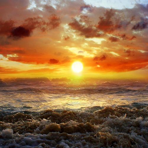 Strong waves at the beach in sunrise wallpaper