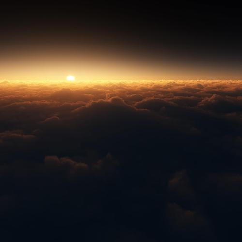 Sun rises over clouds