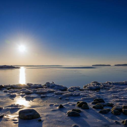 Sunset over frozen bay wallpaper
