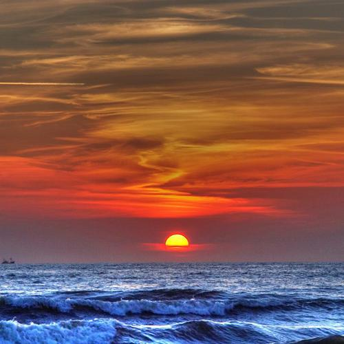 Sunset over ocean wallpaper