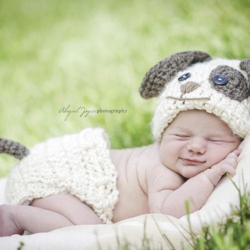 Sweet sleepy baby in puppy suit wallpaper