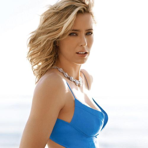 Tea Leoni in blue dress portrait wallpaper