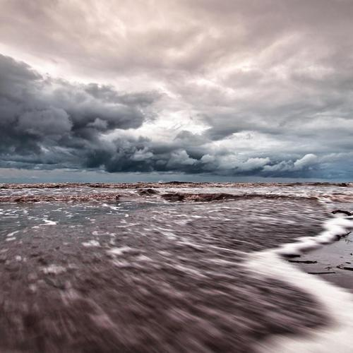 Tide Coming In Under Stormy Skies wallpaper