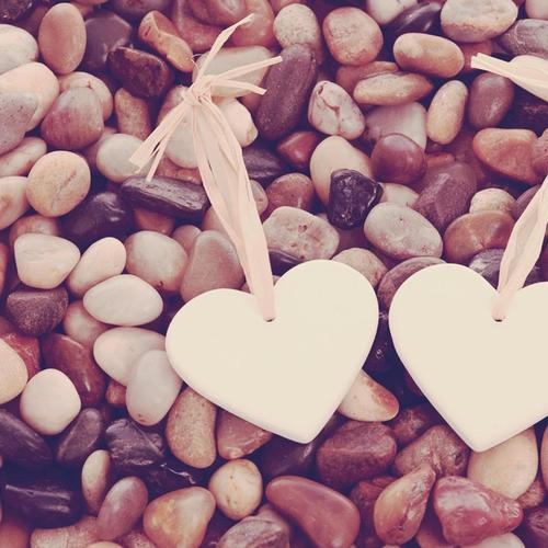 Two hearts pebbles wallpaper
