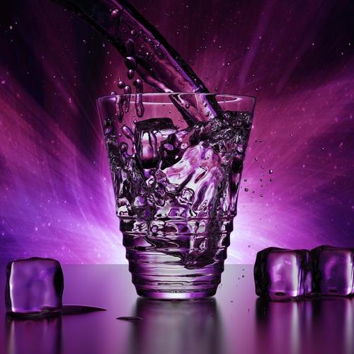 Water cup with ice in dark purple background